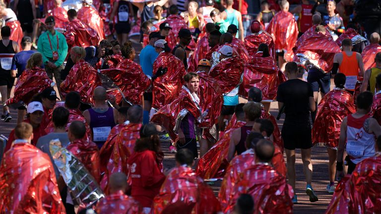 Runners wrapped in foil blankets after finishing the Virgin Money London Marathon