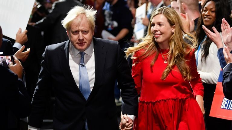 Britain's Prime Minister Boris Johnson departs with his wife Carrie Johnson after delivering a speech during the annual Conservative Party Conference, in Manchester, Britain, October 6, 2021. REUTERS/Toby Melville