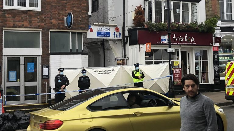 Police at the scene outside the Royal British Legion on High Street in Lymington, Hampshire
