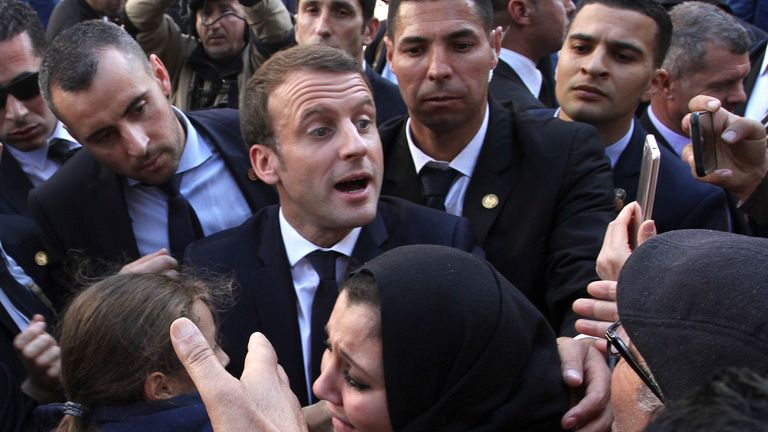 French President Emmanuel Macron meets residents in Algiers in 2017. Pic: AP
