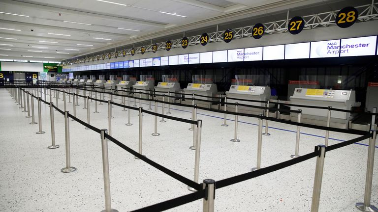 An empty check-in area at Manchester Airport