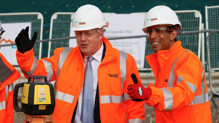 Britain's Prime Minister Boris Johnson and Chancellor of the Exchequer Rishi Sunak visit a construction site in Manchester, Britain, October 4, 2021. REUTERS/Phil Noble/Pool