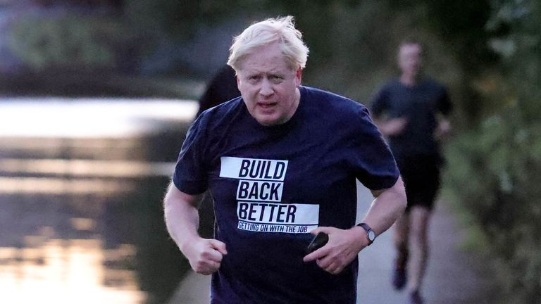 Image ©Licensed to Parsons Media. 06/10/2021. Manchester , United Kingdom. Conservative Party Conference Day Four. Prime Minister Boris Johnson out for a morning run in Manchester on the day he delivers his keynote speech to the Conservative Party Conference. Picture by Andrew Parsons CCHQ / Parsons Media