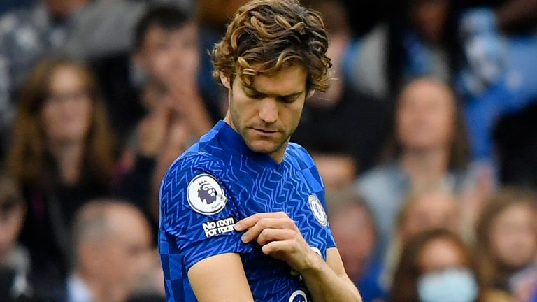 Chelsea's Marcos Alonso pointed to his 'no room for racism' badge as other players took the knee