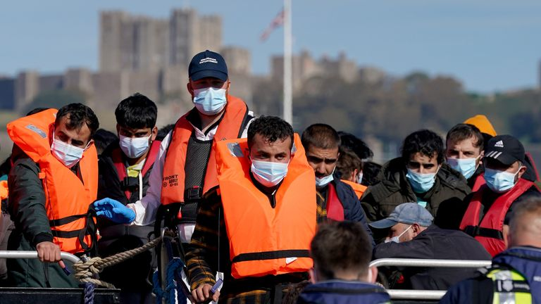 A group of people thought to be migrants are brought in to Dover, Kent, by Border Force officers, following a small boat incident in the Channel. Picture date: Friday October 8, 2021.