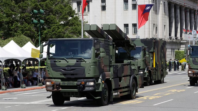 Military vehicles were paraded. Pic: AP
