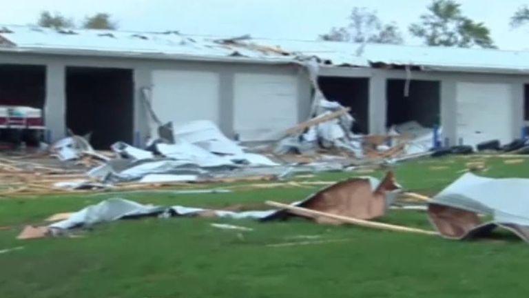 Row of garages damaged by Missouri tornado