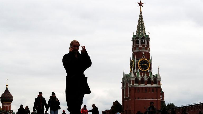 People walk across Red Square in Moscow