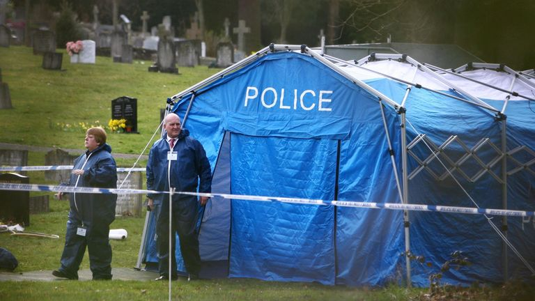 Police forensic officers in in 2009 at Haywards Heath Cemetery in Sussex, where the body of an unidentified man found murdered was exhumed by police