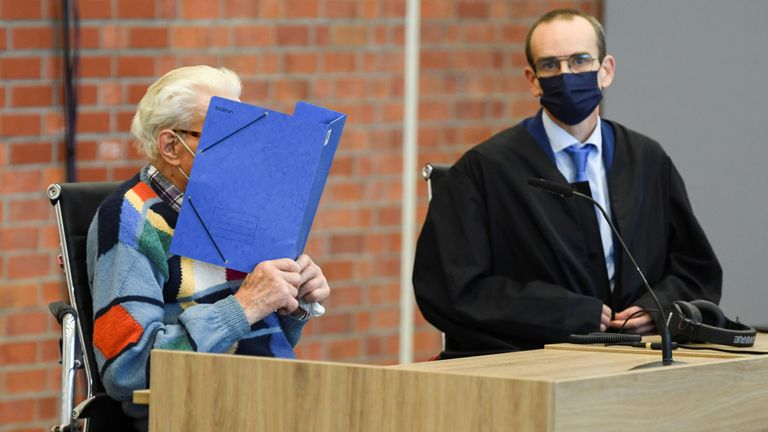 A 100-year-old former security guard of the Sachsenhausen concentration camp appears in the courtroom before his trial at the Landgericht Neuruppin court in Brandenburg, Germany, October 7, 2021. REUTERS/Annegret Hilse