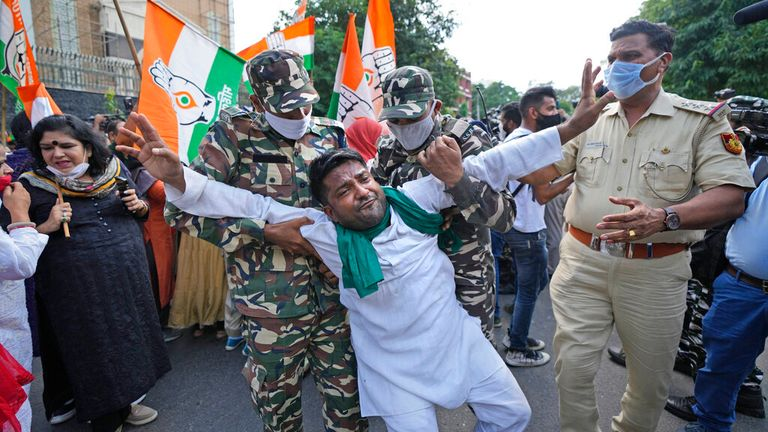 Soldiers detain an activist amid fresh protests in New Delhi over the earlier violence in Lakhimpur Kheri. Pic: AP