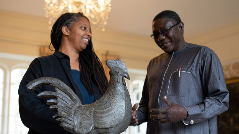 """Master of Jesus College Sonita Alleyne (left) with Director General of Nigeria's National Commission for Museums and Monuments Professor Abba Isa Tijani ahead of a ceremony at Jesus College, Cambridge, where the looted bronze cockerel, known as the Okukur, will be returned to Nigeria. The Legacy of Slavery Working Party concluded that the statue, which was looted by British colonial forces in 1897 and given to Jesus College in 1905 by the father of a student, """"belongs with the current Oba at the"""