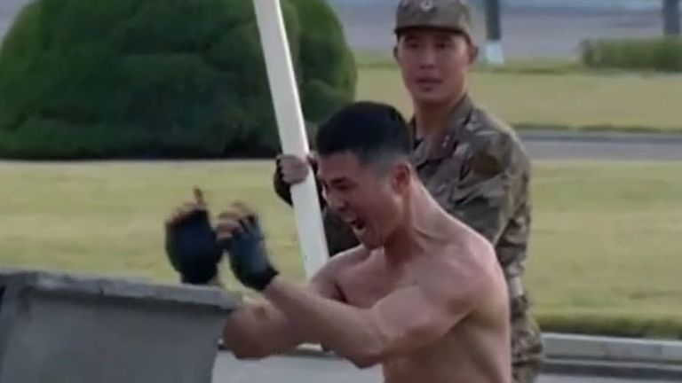 Kim Jong Un watches a display of extreme martial arts in North Korea