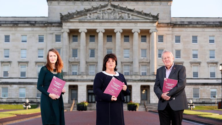 Truth Recovery Design Panel, Dr Maeve O'Rourke, Deirdre Mahon (Chair) and Professor Phil Scraton outside Stormont
