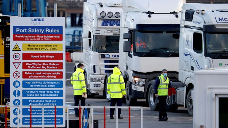 People inspect lorries which arrived at the Port of Larne, Northern Ireland Britain January 1, 2021. REUTERS/Phil Noble