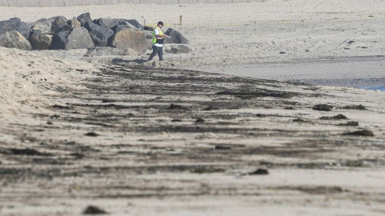 Oil stains are left behind on the State Beach that was closed down after a major oil spill off the coast of California has come ashore in Huntington Beach, California, U.S. October 3, 2021. REUTERS/Gene Blevins