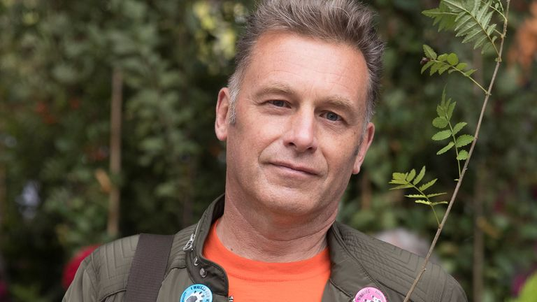 Television presenter and environmentalist Chris Packham holds a plant as he joins Extinction Rebellion and anti-HS2 protesters as they demonstrate outside the High Speed 2 headquarters at Euston Station in London, Britain September 28, 2019. REUTERS/Simon Dawson