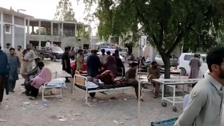 Injured people waiting outside a hospital in Harnai