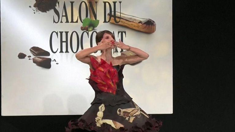 A model in a chocolate dress