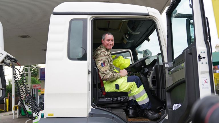 A member of the armed forces sits in the cab of a tanker after helping to deliver fuel to a garage in Waltham Abbey, Essex. Picture date: Tuesday October 5, 2021.