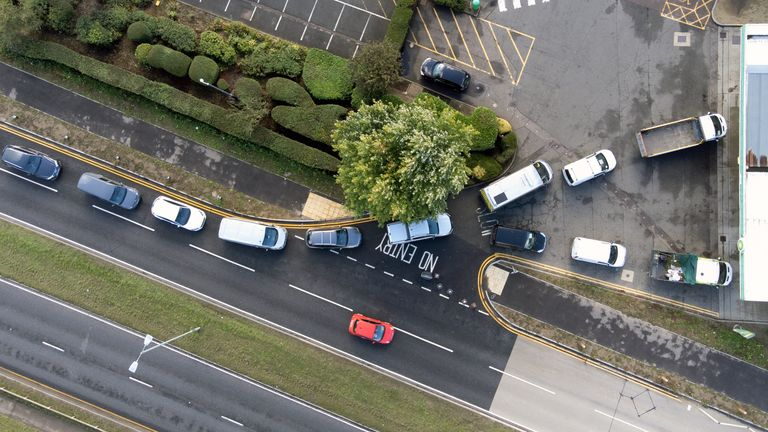 People queue for fuel at a petrol station in Hemel Hempstead. Picture date: Monday October 4, 2021.