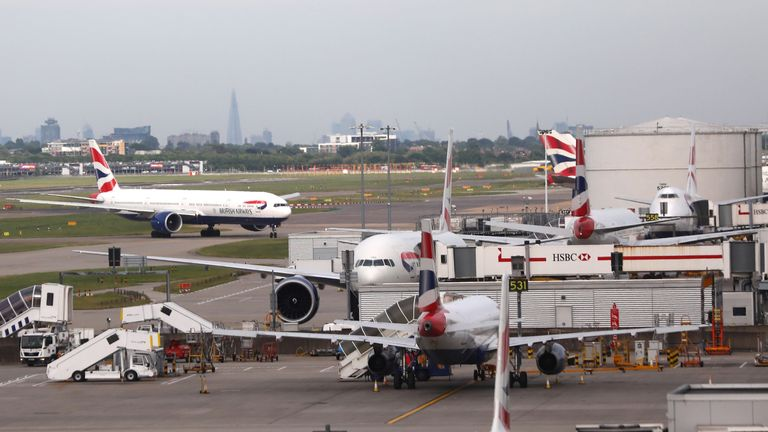 British Airways planes are seen at Heathrow Terminal 5 in London, Britain May 27, 2017. REUTERS/Neil Hall