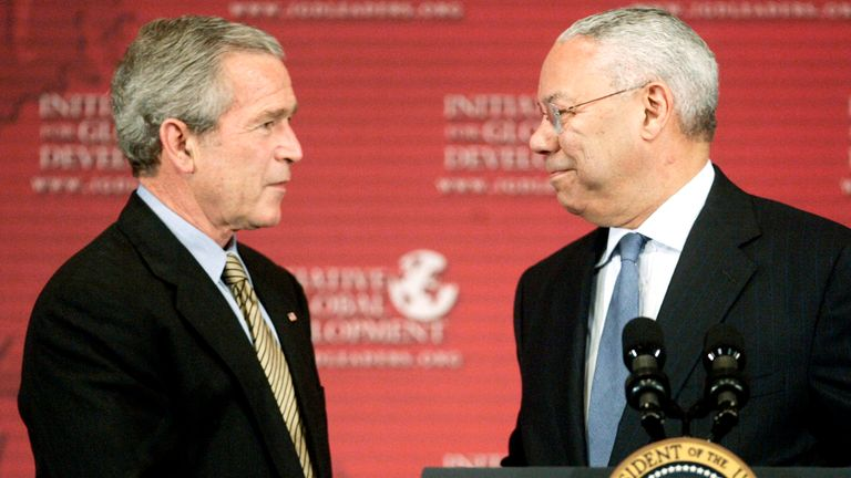 U.S. President George W. Bush (L) is introduced by former Secretary of State Colin Powell as he arrives to deliver remarks at the Initiative for Global Development's National Summit in Washington June 15, 2006. REUTERS/Jim Young (UNITED STATES)