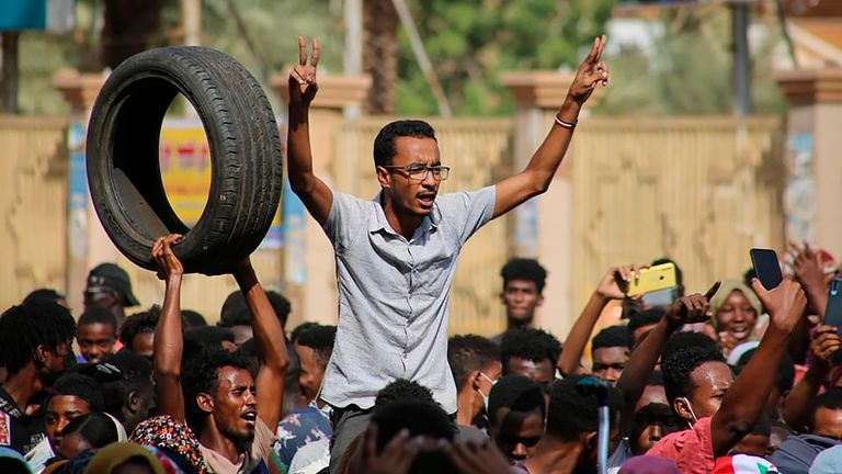 Thousands of pro-democracy protesters take to the streets to condemn a takeover by military officials in Khartoum, Sudan, Monday Oct. 25, 2021.