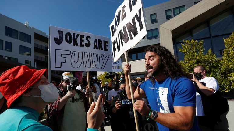 There were scuffles as counter-protesters held up signs that said 'Dave is funny'