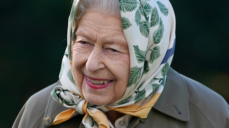 The Queen takes part in a planting at Balmoral on Friday