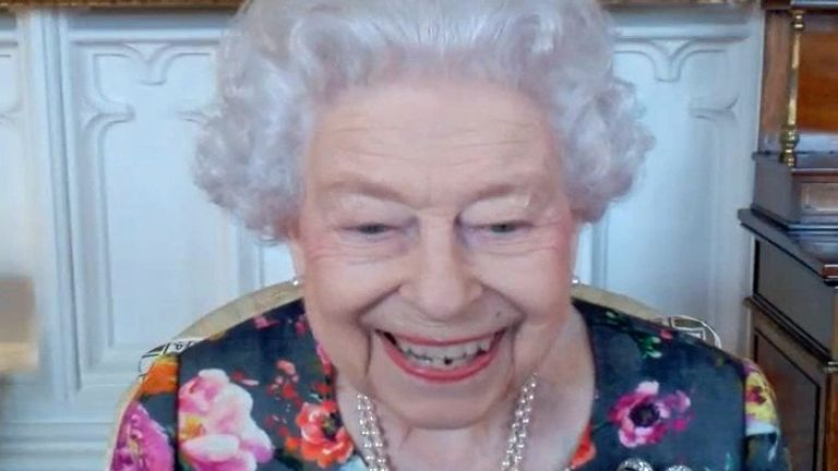 Queen Elizabeth II appears on a screen via videolink from Windsor Castle, where she is in residence, during a virtual audience to receive David Constantine (left), accompanied by Poet Laureate Simon Armitage, and to present him with The Queen's Gold Medal for Poetry, at Buckingham Palace, London. Picture date: Thursday October 28, 2021.