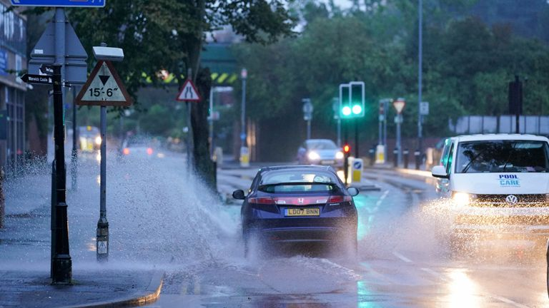 Cars drive through standing water after heavy overnight rain showers in Warwick, Warwickshire. Picture date: Friday October 1, 2021.
