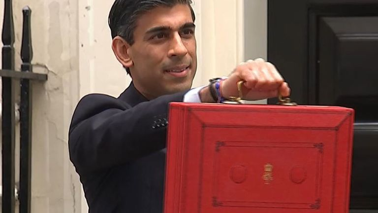 The chancellor poses for photographs with the budget box
