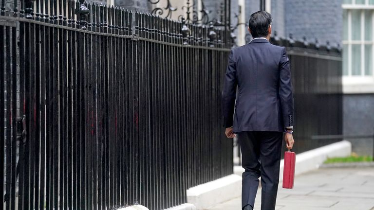 Chancellor of the Exchequer Rishi Sunak carries his ministerial 'Red Box' as he leaves 11 Downing Street before delivering his budget
