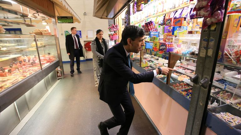 Chancellor of the Exchequer Rishi Sunak looks at a sweet shop during a visit to Bury Market in Lancashire, the day after presenting his budget to the House of Commons. Picture date: Thursday October 28, 2021.