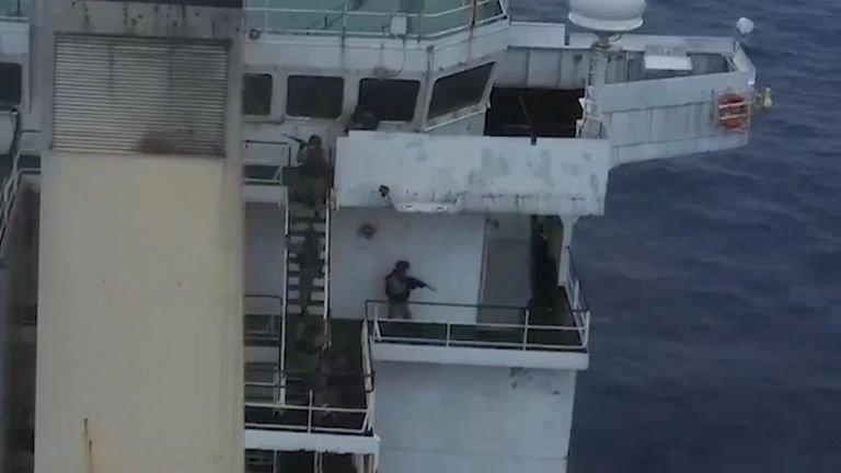 This footage shows an Russian anti-terror group on board the container ship freeing the crew from their hiding spot.