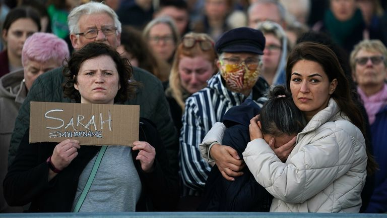 People at a vigil for Sabina Nessa at Eastbourne Pier in East Sussex