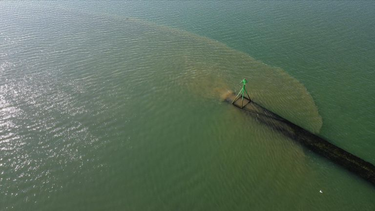 Drone video shows what appears to be sewage outflow into Langstone harbour, Hampshire.