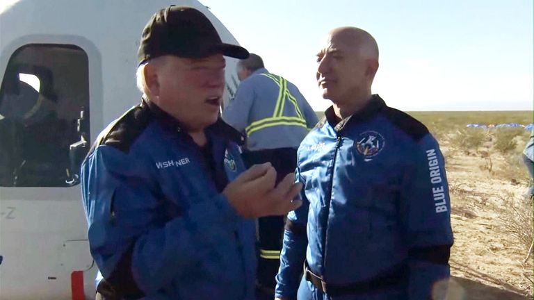 Jeff Bezos and William Shatner speak after the space flight