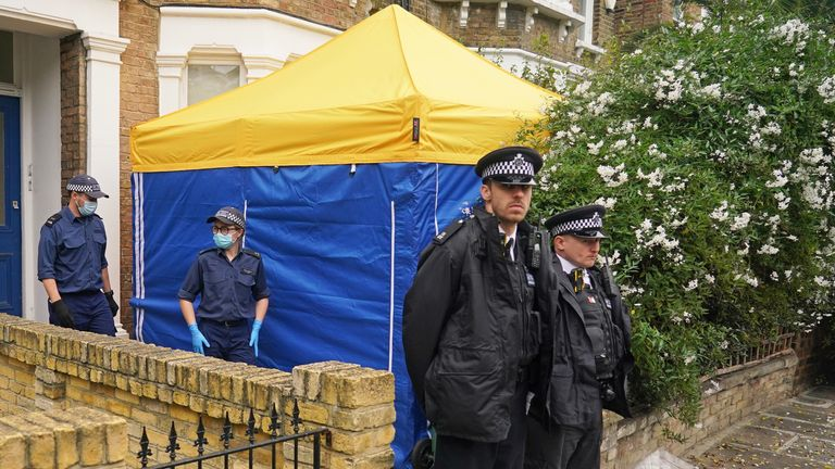 Police officers investigating the killing of Sir David Amess erect a tent outside a house in north London