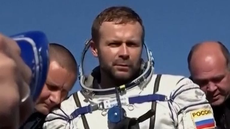 A space capsule carrying two Russian filmmakers has returned to Earth after leaving the International Space Station.