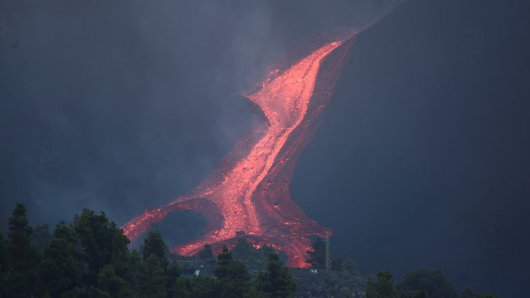 Lava rolls down as the Cumbre Vieja volcano continues to erupt on the Canary Island of La Palma, as seen from Tajuya, Spain, October 11, 2021. REUTERS/Sergio Perez