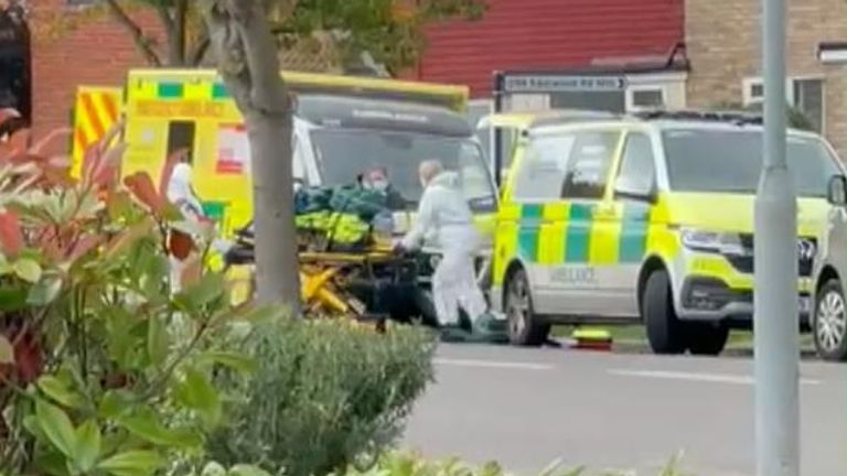 Paramedics appear to carry bags on a stretcher outside scene of Sir David Amess' stabbing in Essex