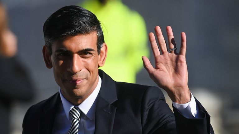 Britain's Chancellor of the Exchequer Rishi Sunak waves as he arrives to attend the annual Conservative Party Conference, in Manchester, Britain, October 6, 2021. REUTERS/Toby Melville