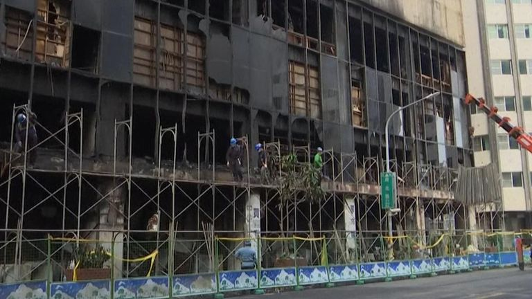 Daylight view of building after fire which killed 46 people