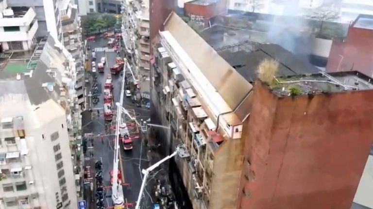 In this image taken from video by Taiwan's EBC, firefighters shoot water into a building that caught fire in Kaohsiung, in southern Taiwan on Thursday, Oct. 14, 2021. The fire engulfed a 13-story building overnight in southern Taiwan, killing some and injuring dozens, the island...s semi-official Central News Agency reported Thursday.  (EBC via AP )