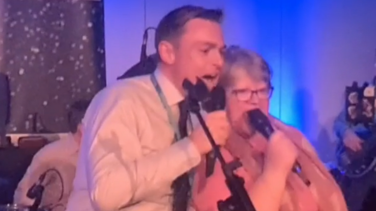Therese Coffey singing with Will Quince