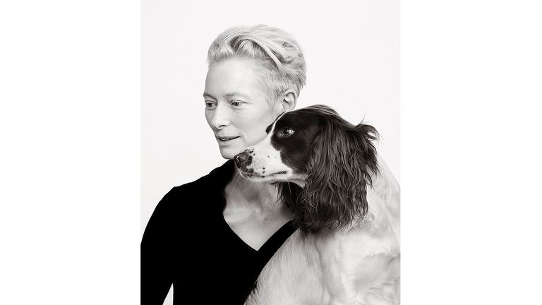 ONE USE ONLY Tilda Swinton with Springer Spaniel Louis Celebrity portrait photographer Andy Gotts has created a series of stunning images of the UK's most famous faces - and their dogs. Must Credit: Andy Gotts / Guide Dogs