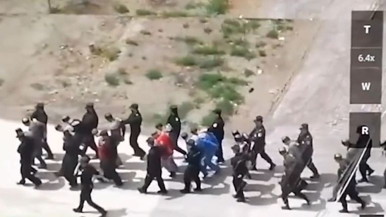 Alleged Uyghur prisoners are led away to detention camp