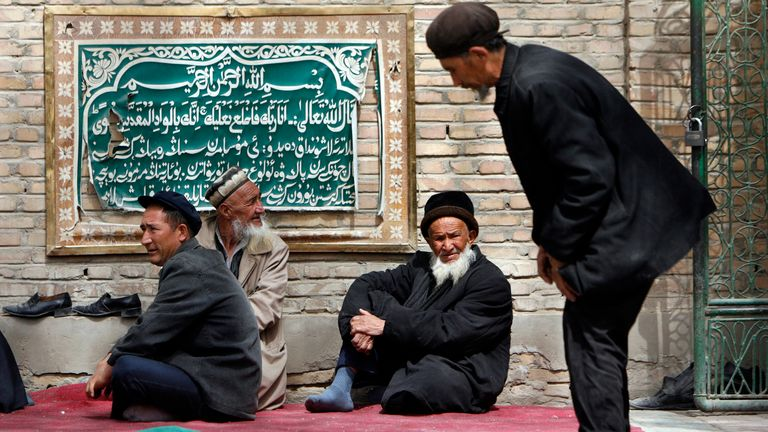 Uighur men attend Friday prayers at the Altyn Mosque in Yarkand, Xinjiang
